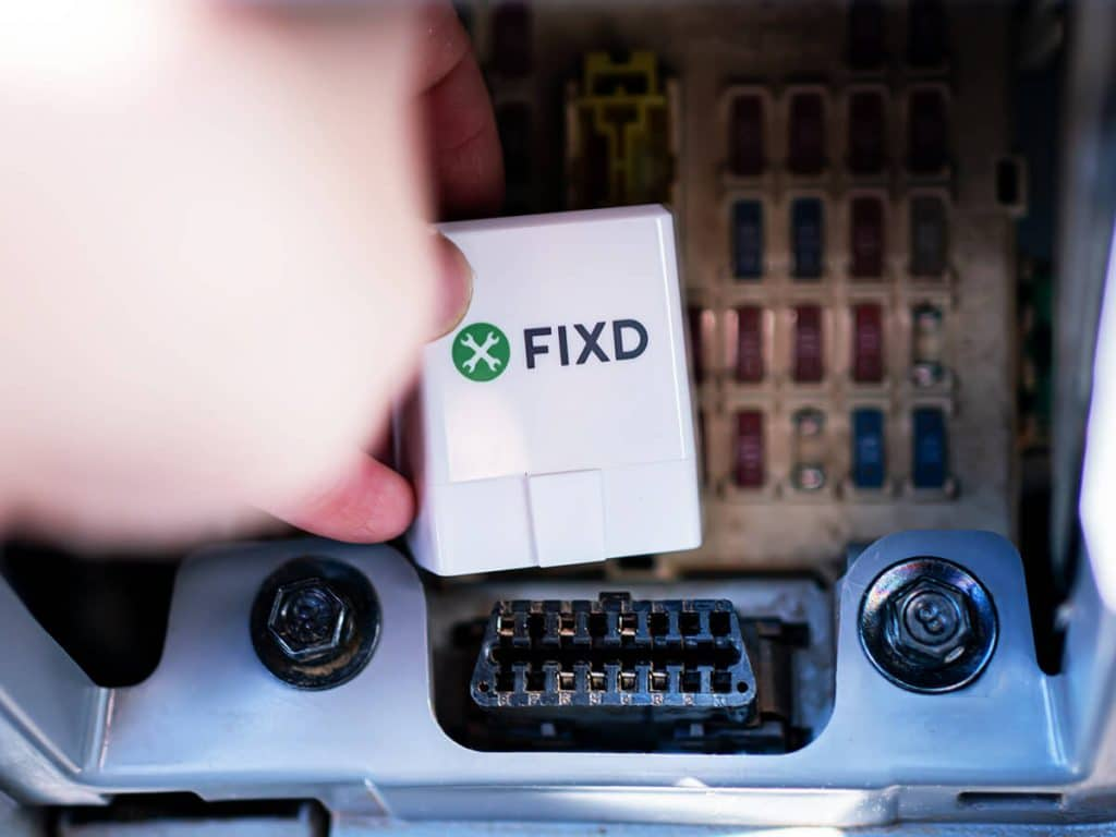 FIXD OBD2 scanner being plugged in