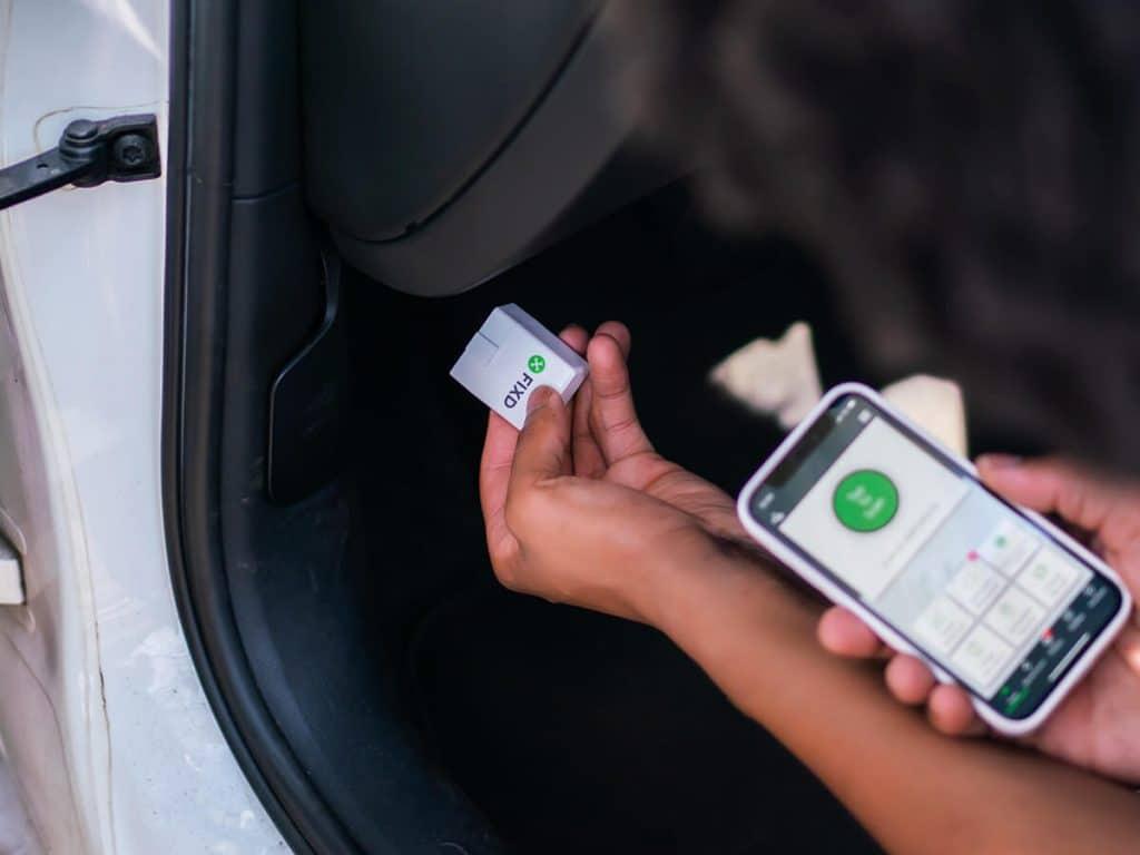 Plugging FIXD OBD2 Scanner into OBD2 Port on Car