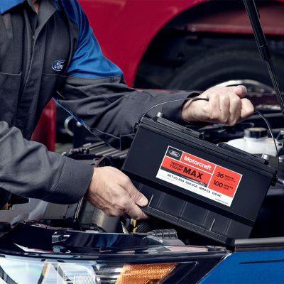 Mechanic replacing dead car battery
