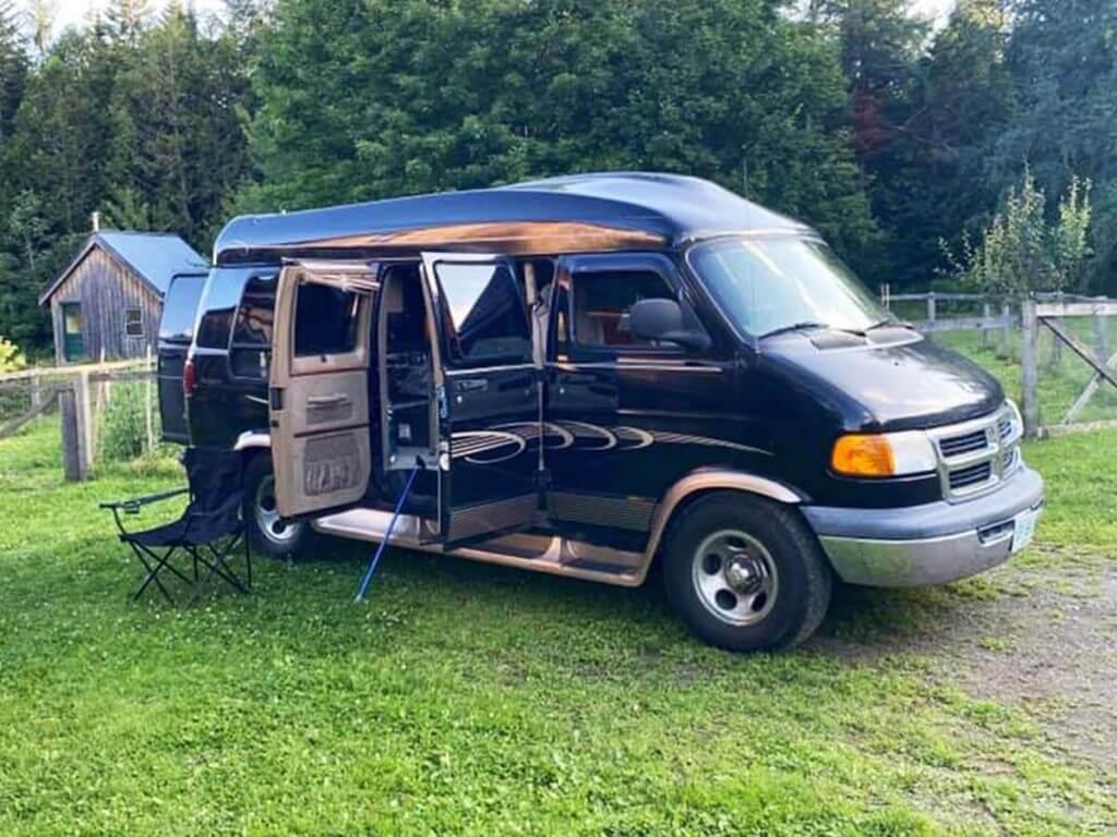 Van camping at a farm