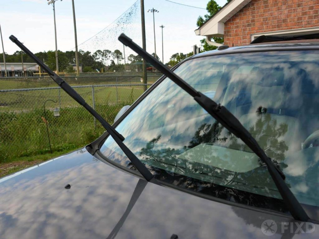 Raised windshield wiper arms