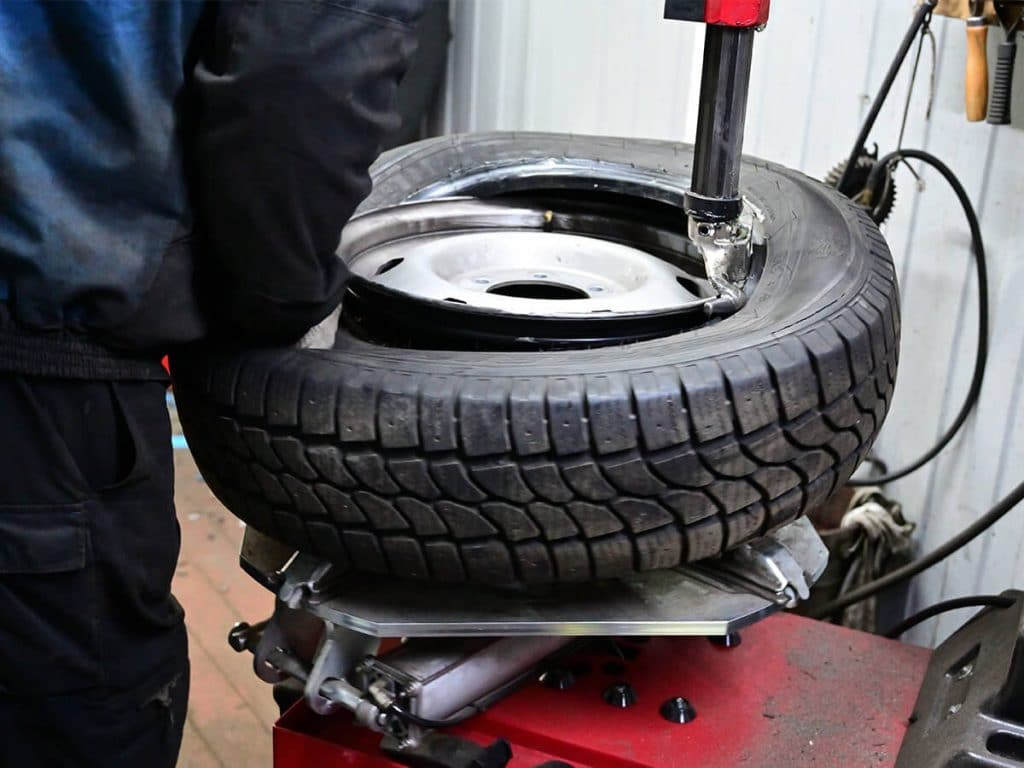 Tire being installed on a wheel