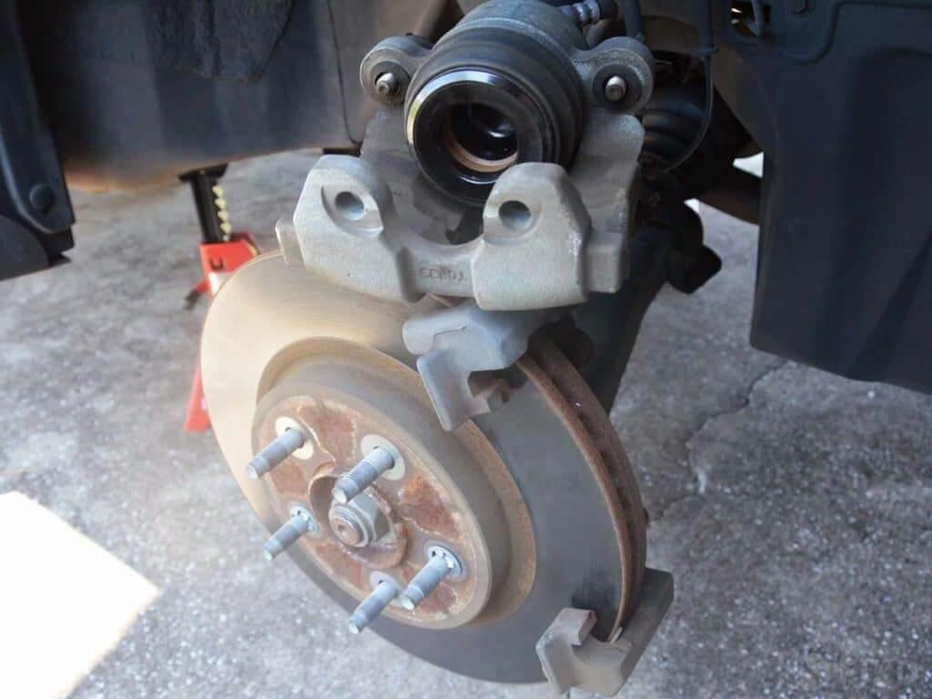 do not hang brake caliper from hose