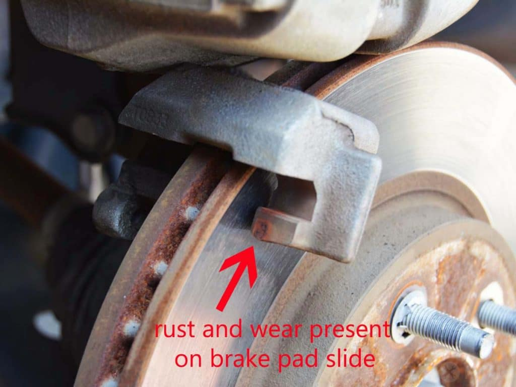 wear visible on front brake pad slide area
