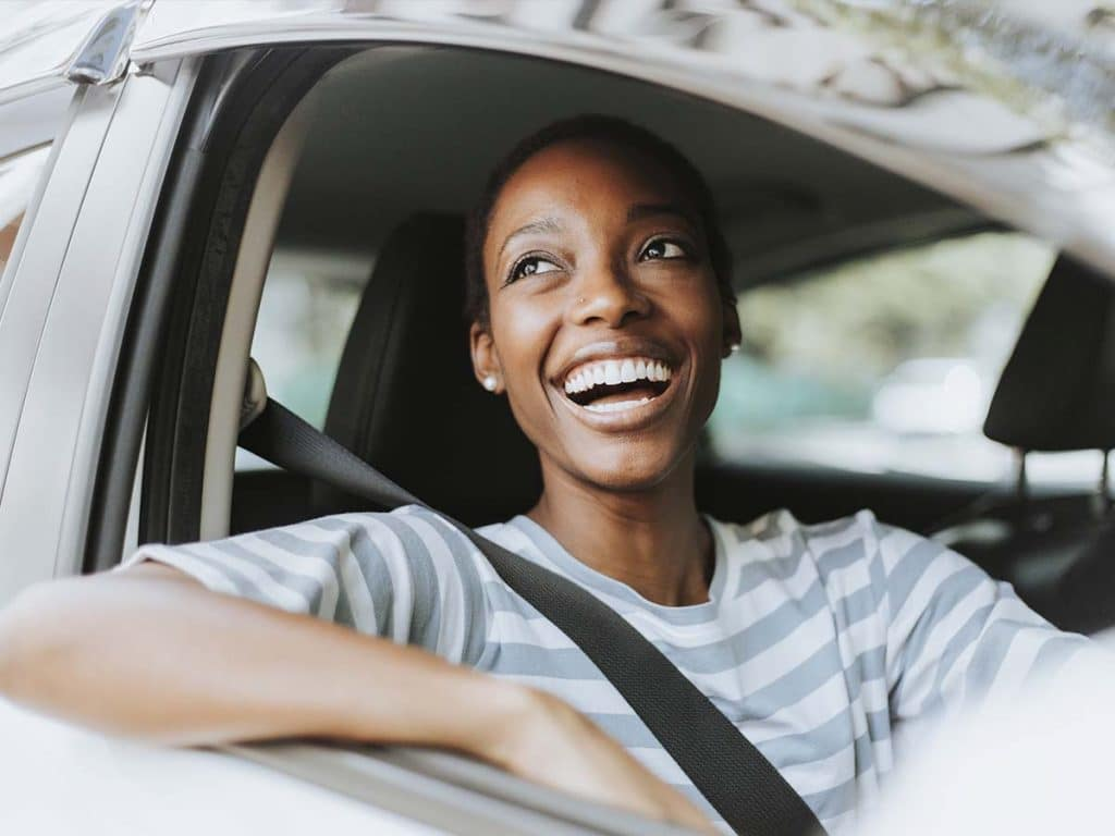 lady in passenger's seat looking very excited and happy